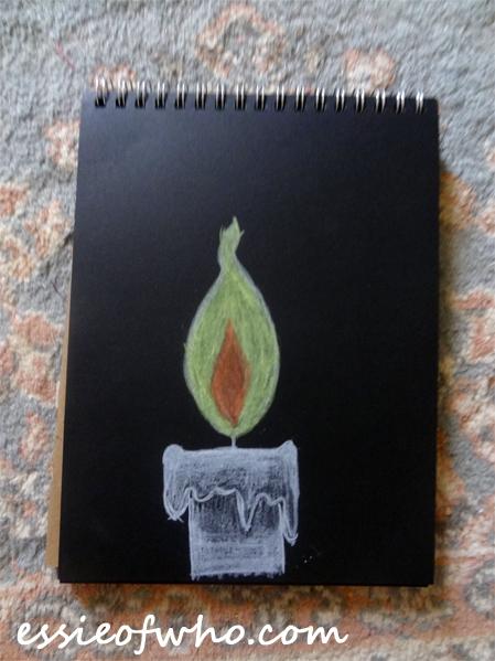 black paper sketch candle